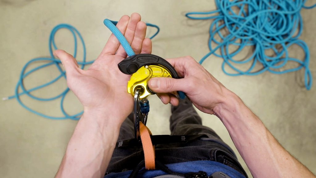 "The ""palm bump"" rotates the device to disengage its grip on the rope without overriding its ability to grip again if the climber falls"