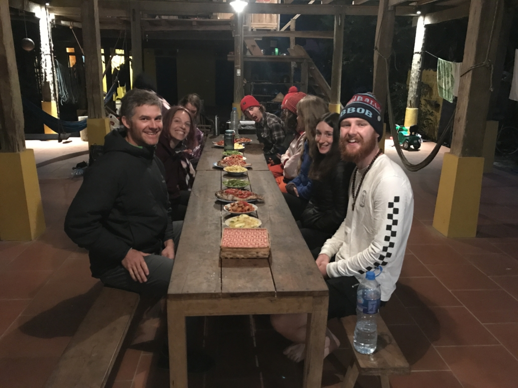 Trango athlete Skiy DeTray at a dinner table with a group of climbers in Huu Long, Vietnam.